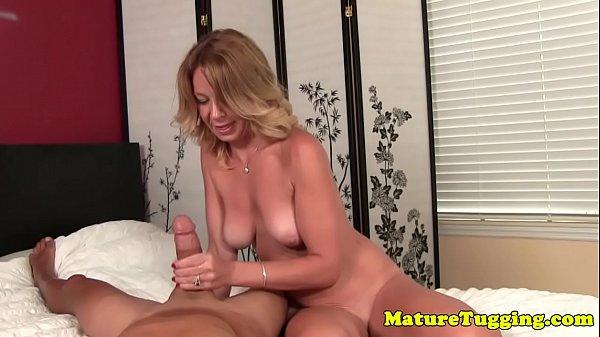 Handjob MILF tugging lucky cock in POV