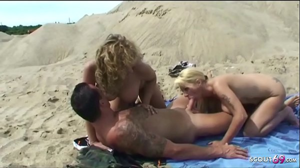 German Big Brother Klaus with two MILF in 3some at Beach Thumb