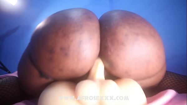 Lonely African woman riding a male torso sex toy