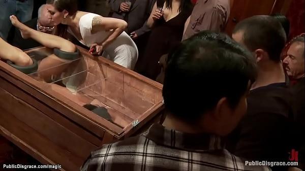 Slut in wooden glass box public fucked