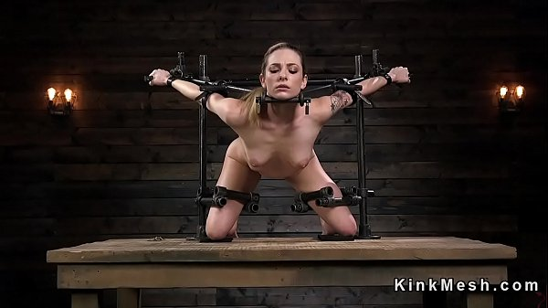 Petite brunette slave beauty in device bondage