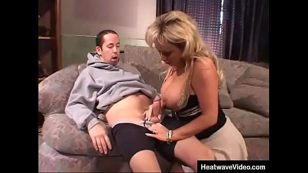 With her huge tits and and a short skirt, this hot MILF easily able to seduce the much y. boy Thumb