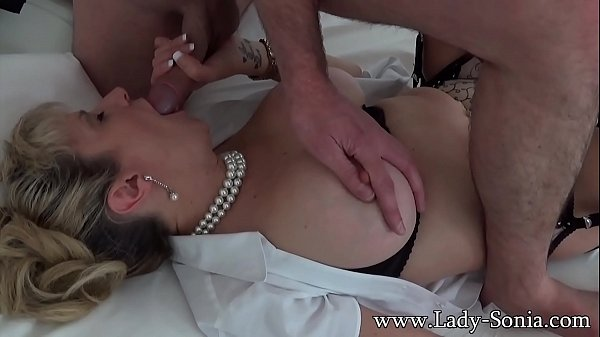 Busty mature blonde Lady Sonia sucking off a ma...