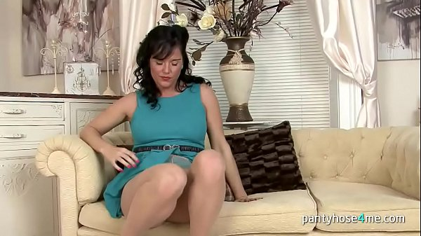 Sexy Chick in Pantyhose Rubs Her Pussy Thumb