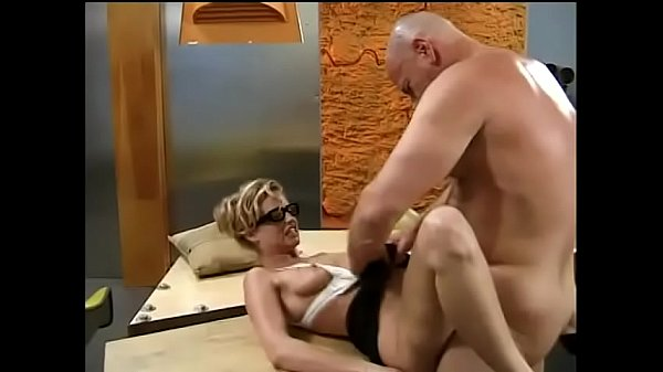 Beautiful blonde Candy Apples sucks off big bald hunk in his office