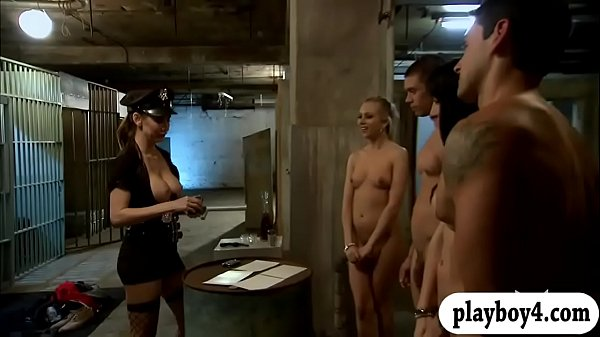 Curvaceous ladies enjoying foursome sex in the jailcell