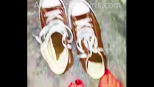 Girl shows her sweaty, stinky Converse sneaker shoes, the insoles are very sweaty and very stinky to wear from barefoot.