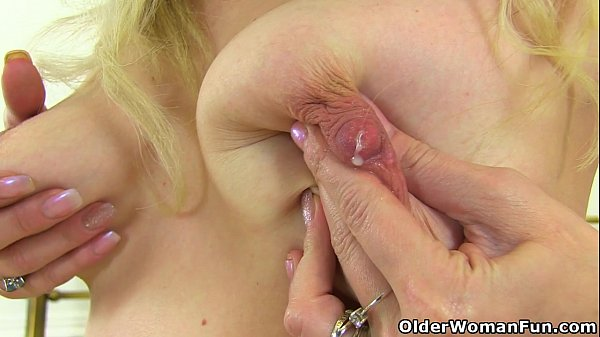 English milf Ashleigh milks her hard nippled tits