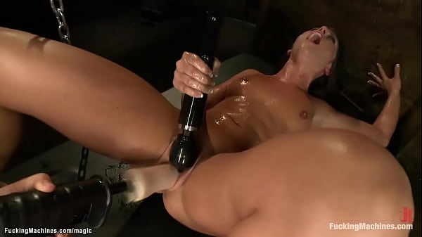Sweaty chained brunette machine fucked Thumb