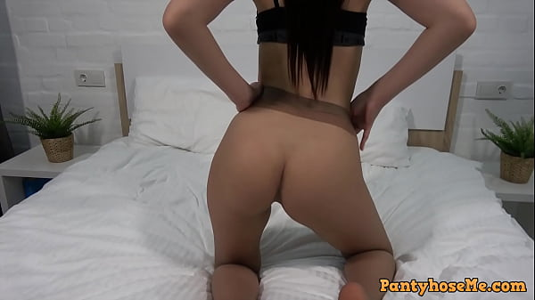 Fit Girl In Sheer Seamless Tan Pantyhose Filming Herself On Bed Thumb