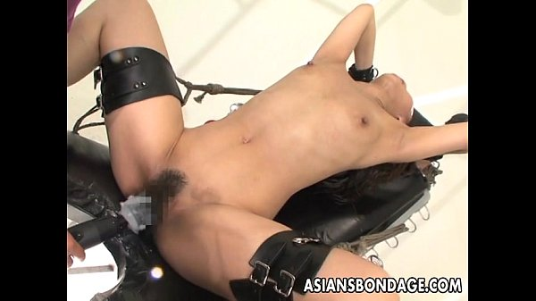 Bound Asian handles sex machines like a trooper  thumbnail