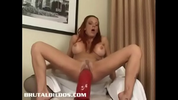 Busty Shannon Kelly gapes her pussy and ass with big dildos