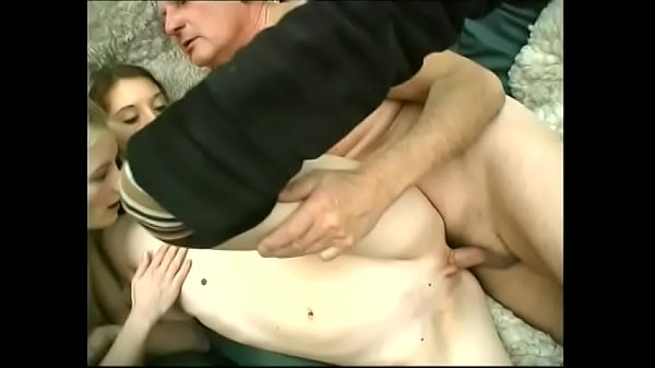 Young girls take turns sucking and being fucked by old dick