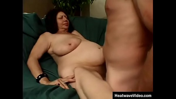 Enormous fat granny grabs the cameraman's cock, who is immediately horny at the sight of her saggy tits