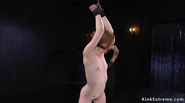 Chained slave gets cattle prod torment