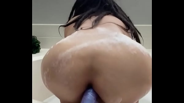 Asian hoe loves her fake cock Thumb