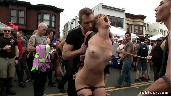 Blonde is pissed in street fair outdoor