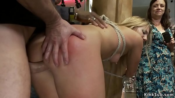 Blonde is anal fucked in public sex shop