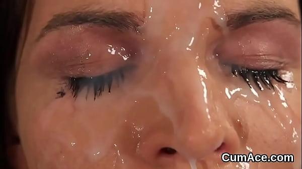 Frisky stunner gets cumshot on her face swallow...