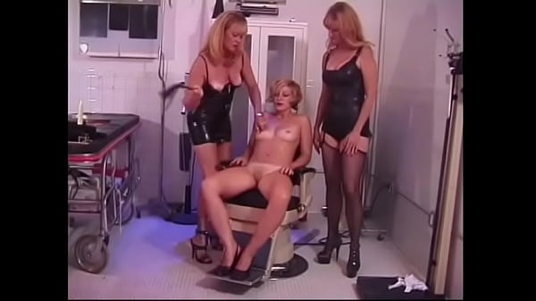 Pretty blonde flinches every time a drop of hot wax falls on her perfect body