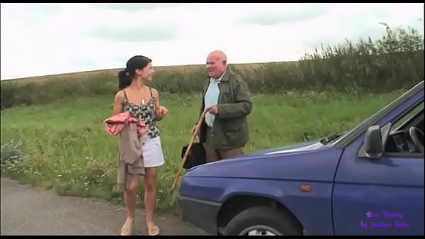 An elderly gentleman see a young girl in trouble with her car Thumb