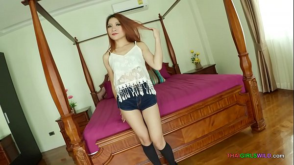 Skinny redhead Thai girl takes it from behind