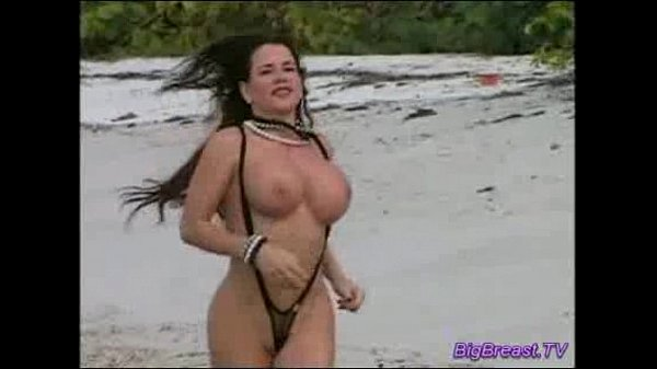 Big breasts babe on the beach