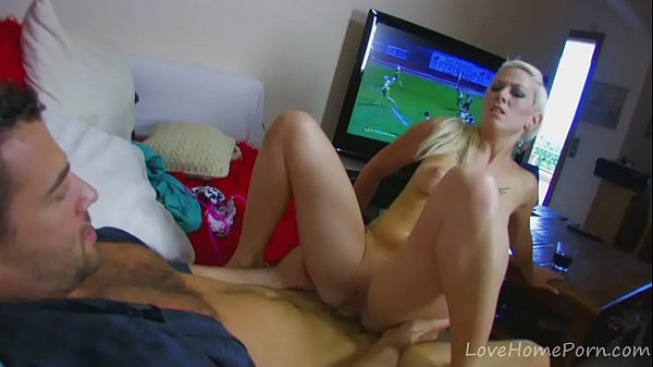 Football on TV and hot anal sex on the couch