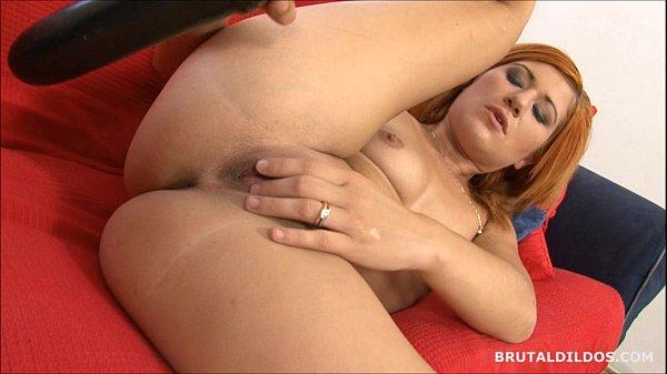 Strawberry blonde beauty swallowing a big b. dildo