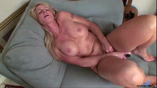 Busty blonde milf toys her twat