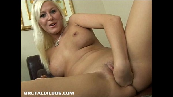 This blonde babe a massive b. dildo in her tight pussy