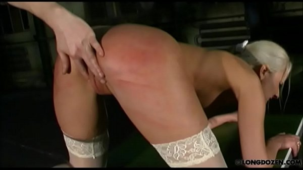 Slender submissive blonde whipped in dungeon