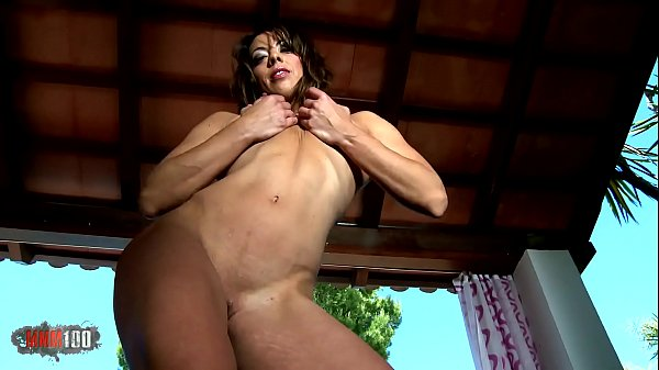 Horny milf Susy Dance removing clothes on the sofa