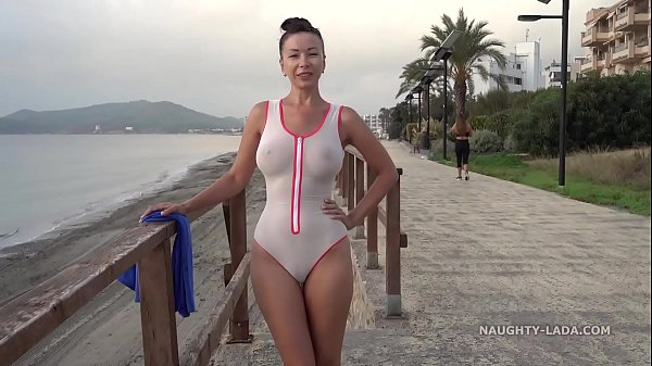 Wet transparent swimsuit in public Thumb