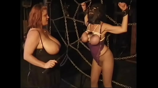 Redhead BBW with huge tits puts a closed mask on her slave's face and fondles her nipples hard Thumb