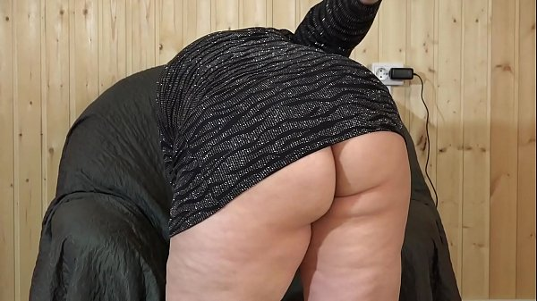 Beautiful BBW in a short dress masturbates in a...