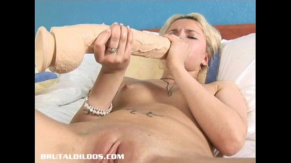 Blonde Russian fills her tight pussy with a big b. dildo