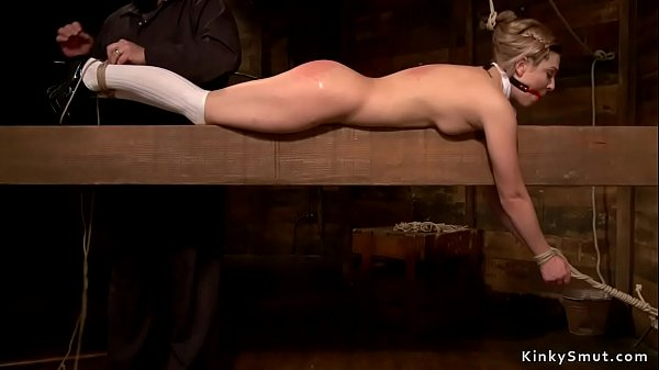 Gagged and tied blonde on timber