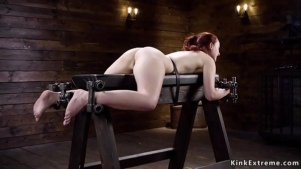 Redhead in doggy bondage ass flogged
