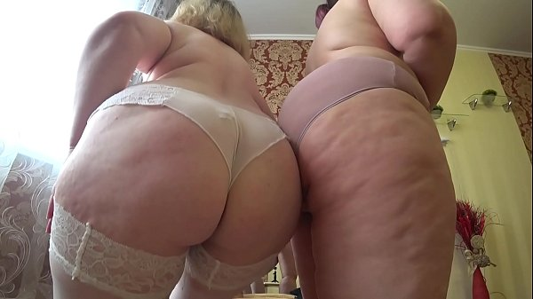 Sexual foreplay of two mature lesbians with fat...