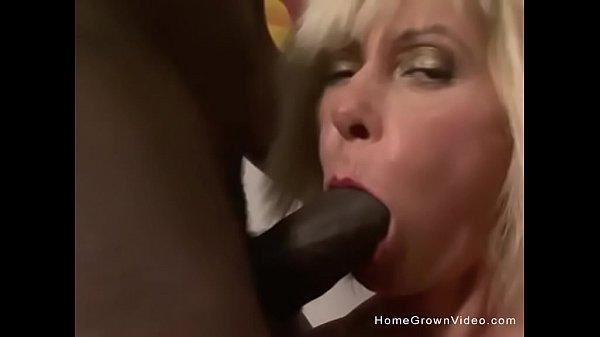 Mature blonde gets a big black cock shoved up her ass