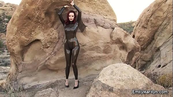Emily Marilyn fetish model in latex catsuit Thumb