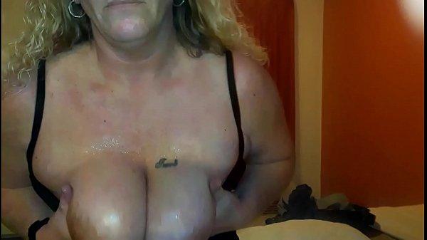 MILF teasing and flashing HUGE tits