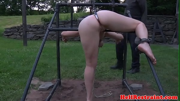 Outdoor sub humiliated with water in pillory Thumb