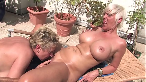 Free Version - This horny blonde granny licks her pussy to the housekeeper on the balcony Thumb