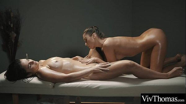 Sexy masseuse gives gorgeous brunette a naked massage then finger-bangs her tight pussy
