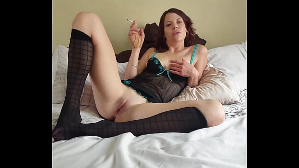 Smoking a cigarette with my legs open while wearing sexy stockings and lingerie