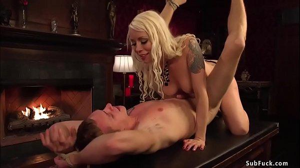 Blonde femdom anal fucks bound man