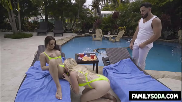 Horny sisters make out in front of pool guy