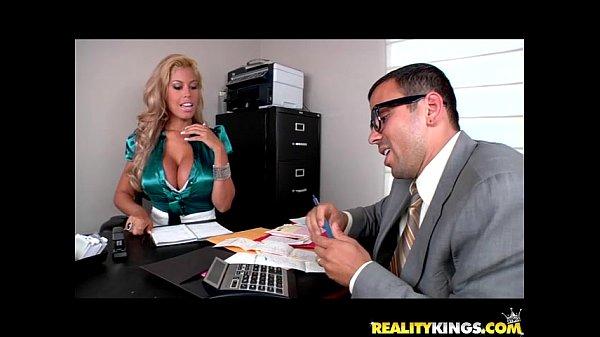 Bridgette B bares her juggs and sucks on Voodoo's big cock
